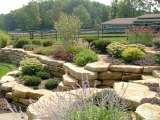 Side view of retaining walls as part of a landscape design done by a Landscape Architect.