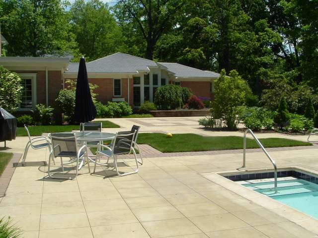 Swimming pool and terrace located in rear of Shaker Heights Ohio Residence.