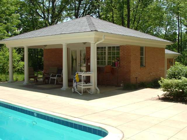 Pool cabana incorporated into landscape design at residence located near Beachwood Ohio