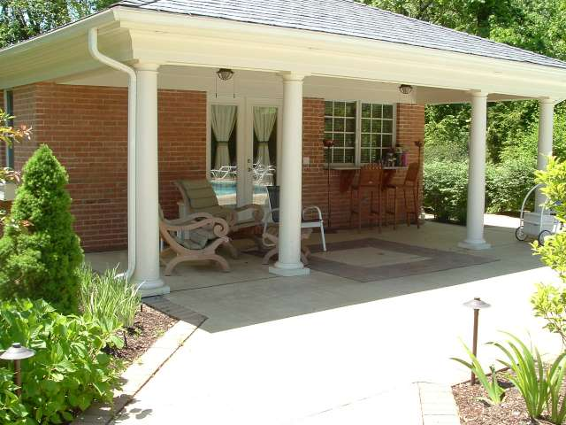 Front of brick cabana with pillars designed by landscape architect located in Cuyahoga County Ohio.